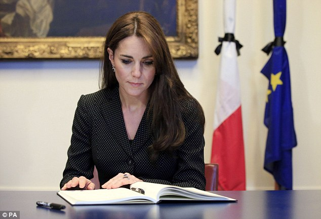 William and Kate visited the French embassy in Knightsbridge, London, to sign a book Photo (C) GETTY IMAGESWilliam and Kate visited the French embassy in Knightsbridge, London, to sign a book Photo (C) GETTY IMAGES