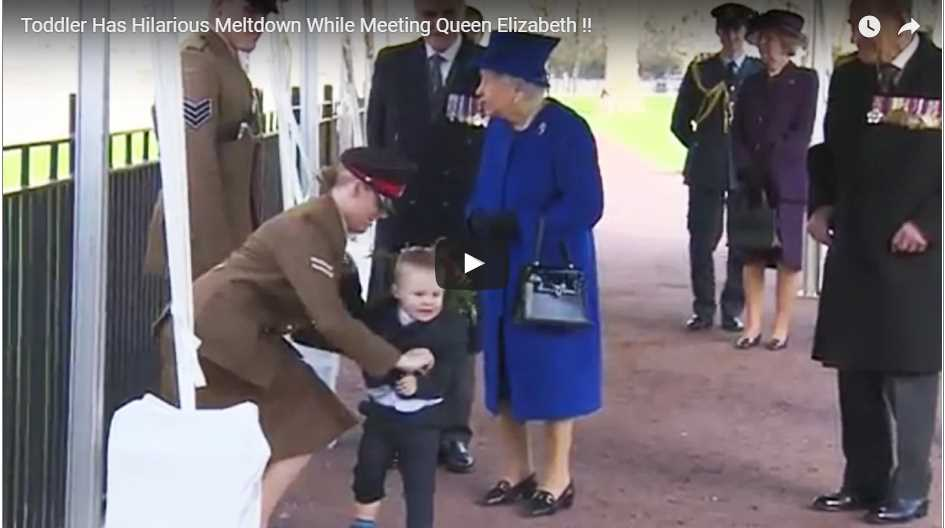 the little boy squirmed in his mother's arms, tried to jet away from the Queen and even fell to the floor in frustration as his embarrassed mother, in military uniformthe little boy squirmed in his mother's arms, tried to jet away from the Queen and even fell to the floor in frustration as his embarrassed mother, in military uniform