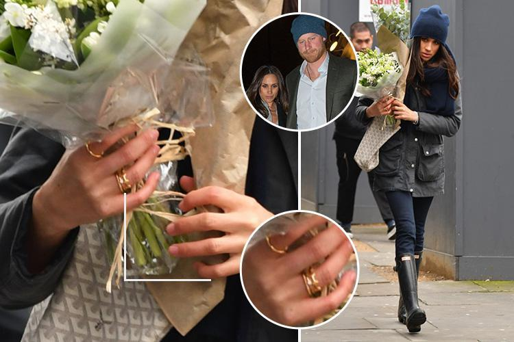 2 Meghan Markle Wearing Golden Ring with H while Dating Prince Harry in Canada Photo C GETTY IMAGES