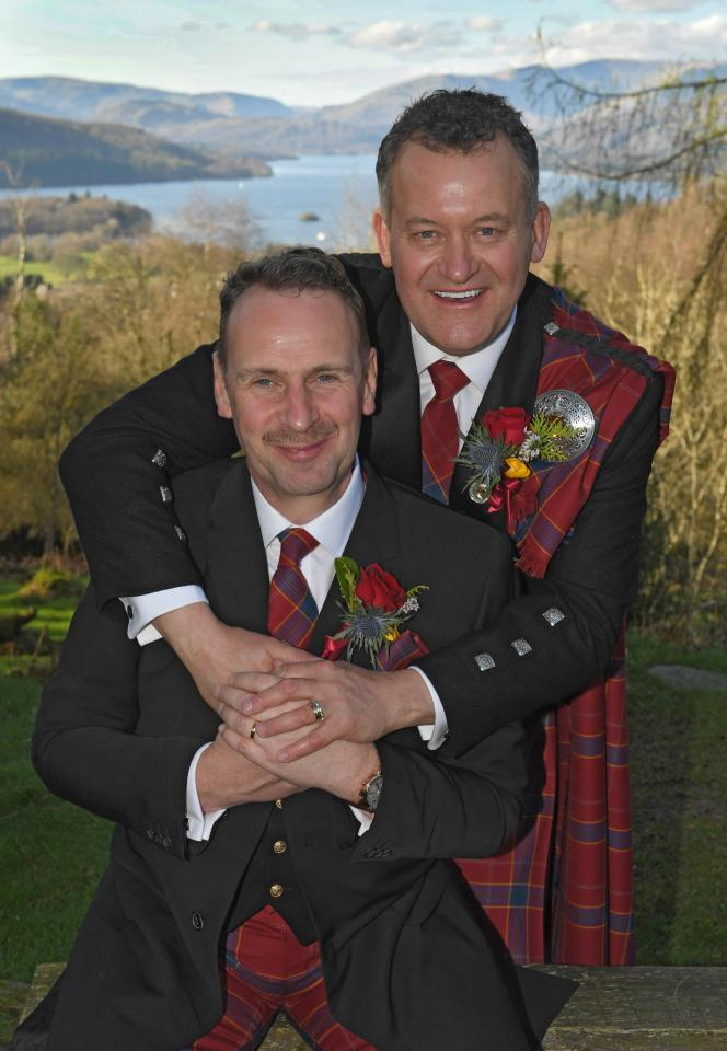 Big day . . . Paul and Graham show off their wedding rings Photo (C) GETTY IMAGES