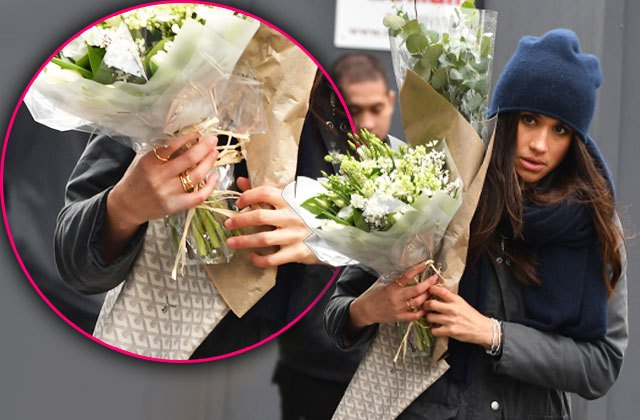 Meghan Markle Wearing Golden Ring with H while Dating Prince Harry in Canada Photo (C) GETTY IMAGES