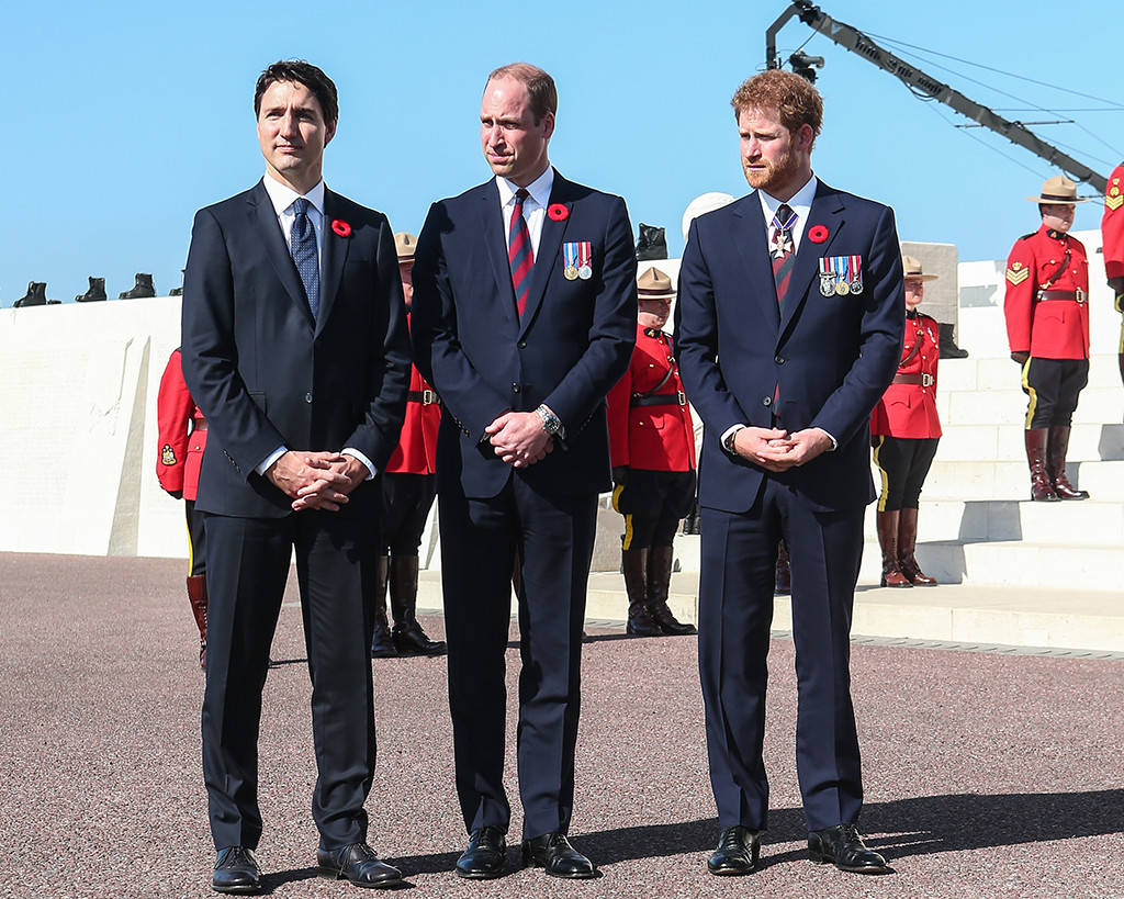 Prince William Prince Harry and Justin Trudeau came together Sunday to remember the armed forces who sacrificed their lives at the 1917 Battle of Vimy Ridge. Phoot C WENN COM