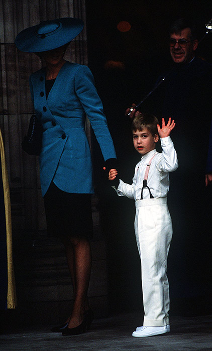 Prince William held his mum's, Diana, Princess of Wales, hand as they entered the church. Diana looked stylish in a royal blue ensemble, and waited patiently for her son as he gave a wave to the cameras before entering the church. Photo: © Getty Images