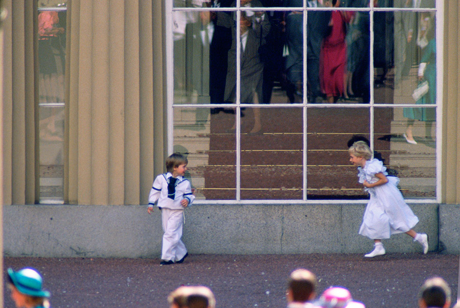 Prince William laughed while he was being chased by Lady Davina Windsor outside Buckingham Palace. Lady Davina was also dressed up the nines in a cute light blue frock with matching shoes, and the rest of the guests made the royal children no mind as they enjoyed the special day. Photo: © Getty Images