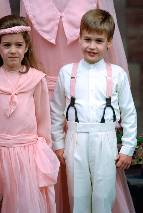 Prince William wore pink braces and a white and cream ensemble to match the bridesmaids while pageboy for the society wedding of Camilla Dunne to Rupert Soames at the Hereford cathedral. The second-in-line to the throne looked simply adorable as he smiled for the cameras. Photo: © Getty Images