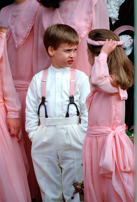 The Prince looked like he was taking his pageboy duties in his stride as he put his hands in his pockets while surrounded by bridesmaids dressed in bold pink. Photo: © Getty Images