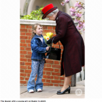 The Queen with a young girl on Easter in 2003.