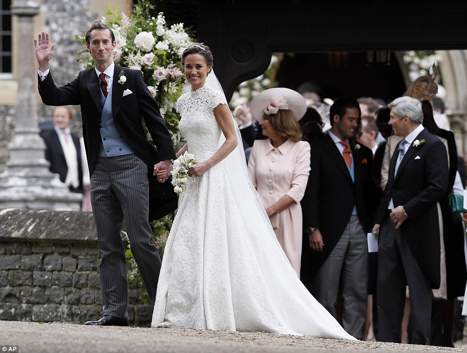 Bride Pippa Middleton and her new husband James Matthews cheer and wave as they leave the private estate 0002