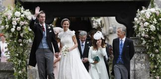 Bride Pippa Middleton and her new husband James Matthews cheer and wave as they leave the private estate 0007