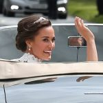 Bride Pippa Middleton and her new husband James Matthews cheer and wave as they leave the private estate 0016