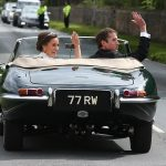 Bride Pippa Middleton and her new husband James Matthews cheer and wave as they leave the private estate 0022
