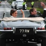 Bride Pippa Middleton and her new husband James Matthews cheer and wave as they leave the private estate 0026