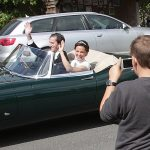 Bride Pippa Middleton and her new husband James Matthews cheer and wave as they leave the private estate 0030