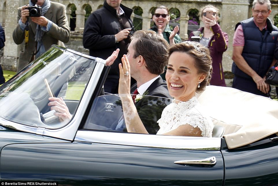Bride Pippa Middleton and her new husband James Matthews cheer and wave as they leave the private estate 0028