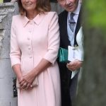 Bride Pippa Middleton and her new husband James Matthews cheer and wave as they leave the private estate 0040