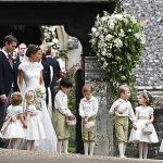 Duchess Kate helps the bridesmaids and pageboys at the wedding Photo C GETTY IMAGES