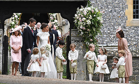 Duchess Kate helps the bridesmaids and pageboys at the wedding Photo (C) GETTY IMAGES