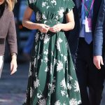Kate chose the perfect dress for the occasion green with a classic white floral print and beamed as she was treated to a tour of the grounds by event organisers