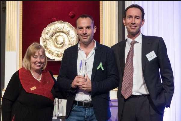 Martin picks up his Beacon Award (UK Community Foundation/PA)