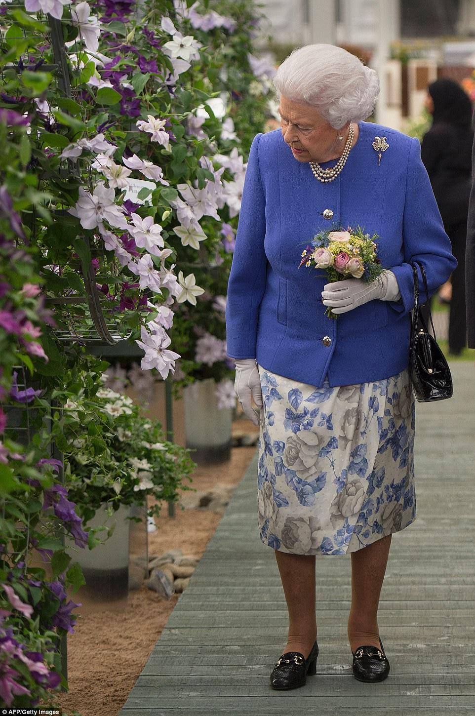 The Queen looked enthused as she was treated to a tour of the grounds