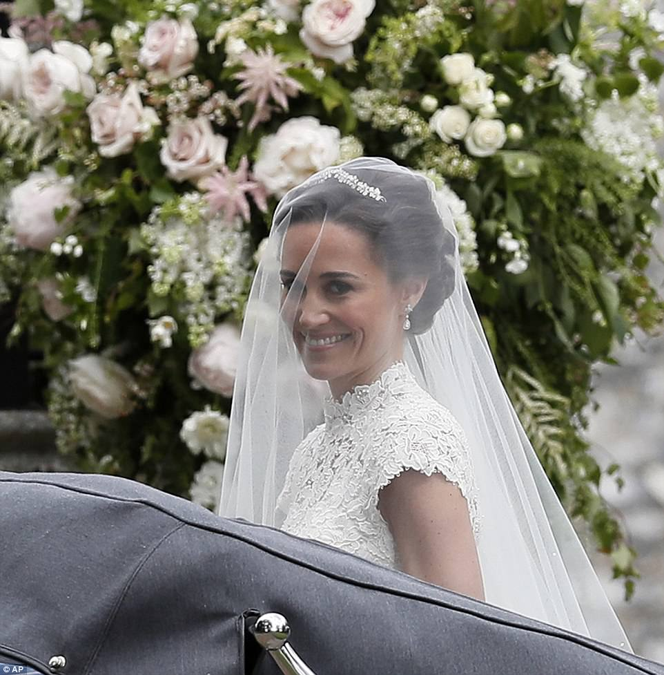 Bride Pippa Middleton and her new husband James Matthews cheer and wave as they leave the private estate 0037