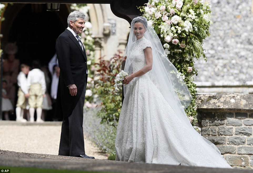 Pippa beamed with joy whilst her father admired her dress when the pair arrived at the wedding in a Jaguar Mark V