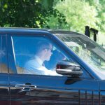 Prince William who looked dapper in a satin waistcoat and red tie drove his family of four in their Range Rover to the society wedding of the decade