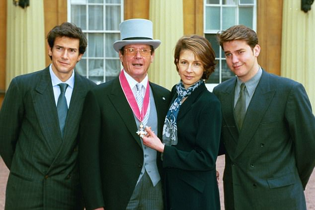 Sir Roger is pictured with his children Geoffrey, Deborah and Christian after he was appointed CBE at Buckingham Palace in 2003