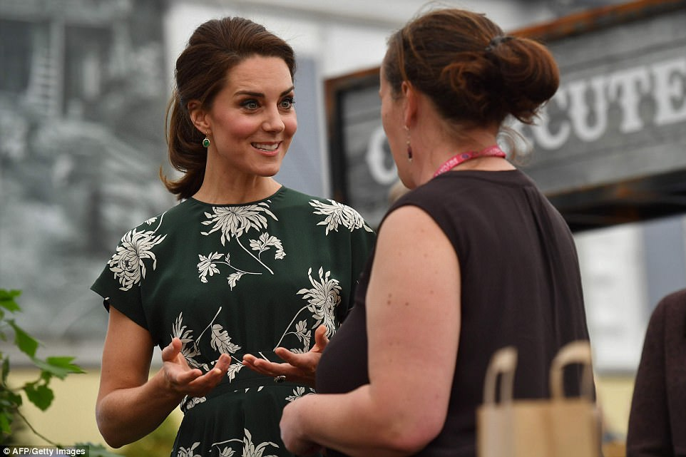 The Duchess of Cambridge was animated as she talked to an exhibitor during her visit the Chelsea Flower Show in London