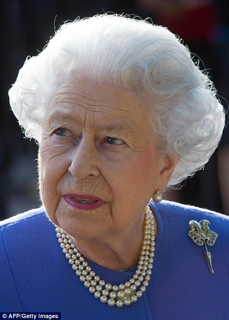 The Queen embraced the sunnier climes in a blue floral skirt and jacket. She offset the look with a pearl necklace