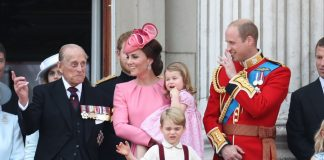 Are you not entertained Prince George looks down at the crowd while Philip medals on display jokingly gestures 1