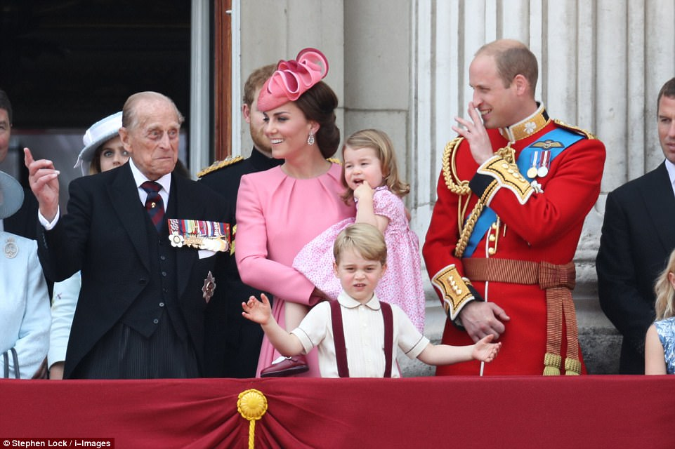 Are you not entertained Prince George looks down at the crowd while Philip, medals on display, jokingly gestures