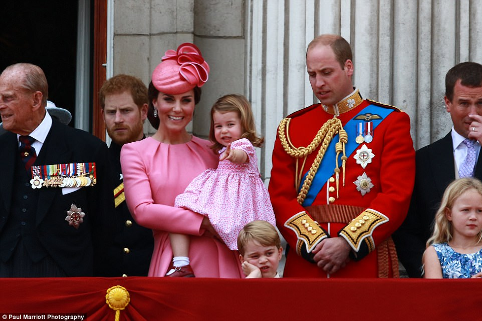 As the Royal Family gathered on the balcony following the Trooping the Colour parade, Charlotte, carried by the Duchess of Cambridge, pointed into the crowd