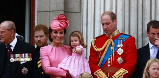 As the Royal Family gathered on the balcony following the Trooping the Colour parade Charlotte carried by the Duchess of Cambridge pointed into the crowd
