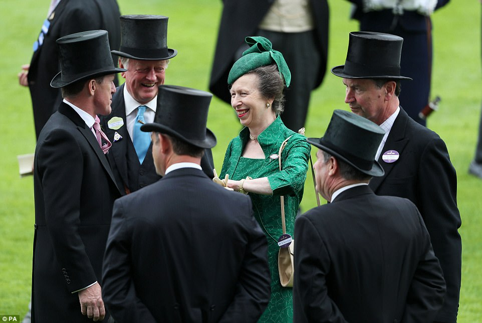 Brigadier Andrew Parker Bowles (second left), The Princess Royal and Vice Admiral Sir Timothy Laurence (right) catch up in the parade ring