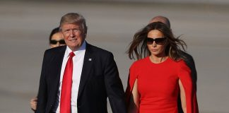 Donald Trump and his wife Melania had an awkward hand hold Friday on the tarmac