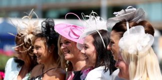 Female racegoers pose up a storm ahead of enjoying all the action on the track