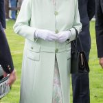 Her Majesty looked her elegant best in a mint green ensemble which featured pink accents both in the paisley design on her dress and the ribbon in her hat