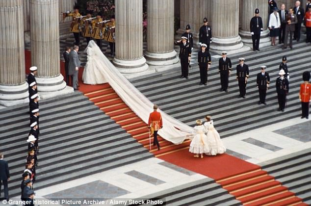 India (left) carrying Diana's train up the steps at St Paul's