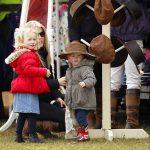 Isla Phillips tried on an oversized chapeau with her mother Autumn Phillips and older sister Savannah Phillips at the Gatcombe Horse Trials in 2014 Photo C MAX MUMBY INDIGO GETTY IMAGES