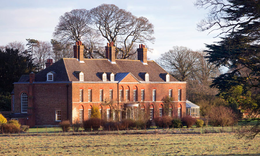 It's at Anmer Hall, the Cambridge's country home in Norfolk, where Charlotte will be able to live a more normal life and attend school nearby like her brother Photo (C) GETTY