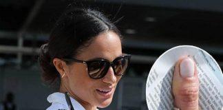 Meghan shows off diamond ring from Prince Harry Photo C SPLASH