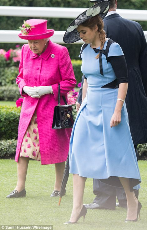 Mind how you go! Princess Beatrice treads carefully across the grass in her spiky heels