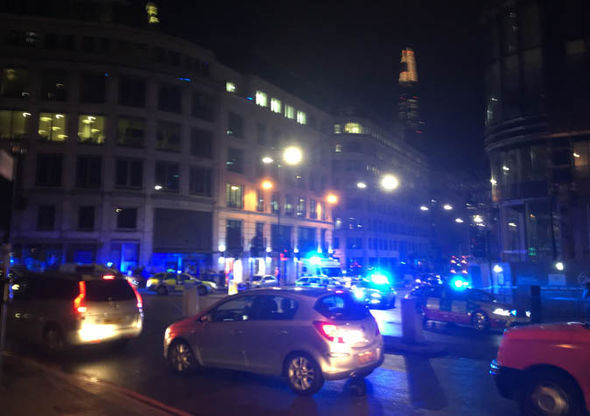 Police at the scene of the incident in London Bridge Photo (C) EXPRESS