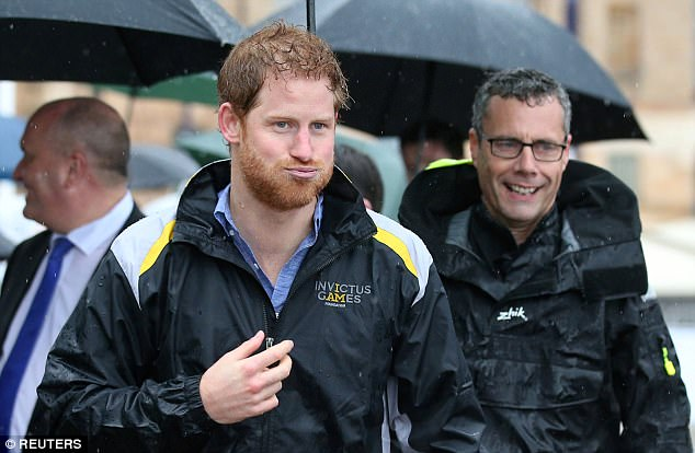Daphne Dunne 97 left was first in line to meet Prince Harry right on Wednesday after waiting in the pouring rain for more than seven hours at Campbell Cove jetty in Sydney