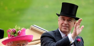 Prince Andrew gives a cheerful wave as he sits alongside his mother in the carriage on the way to Ascot