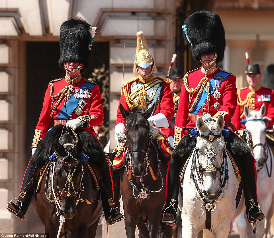 Prince Charles (left) and Prince William (right) took part in the parade on horseback and wearing bearskins