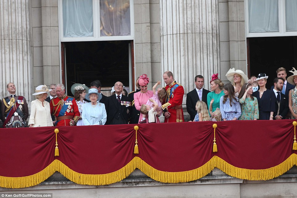 Prince George and Princess Charlotte joked with their parents in the centre of the Buckingham Palace balcony as the rest of the royal family looked on