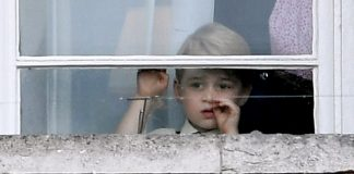 Prince George could be seen mouth agape and head tilted to the sky watching the planes although at other intervals looked rather bored