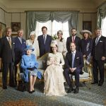 Prince Harry pictured with some of the Royal Family in 2013. Kate Duchess of Cambridge holds her son Prince George seated next to Queen Elizabeth II
